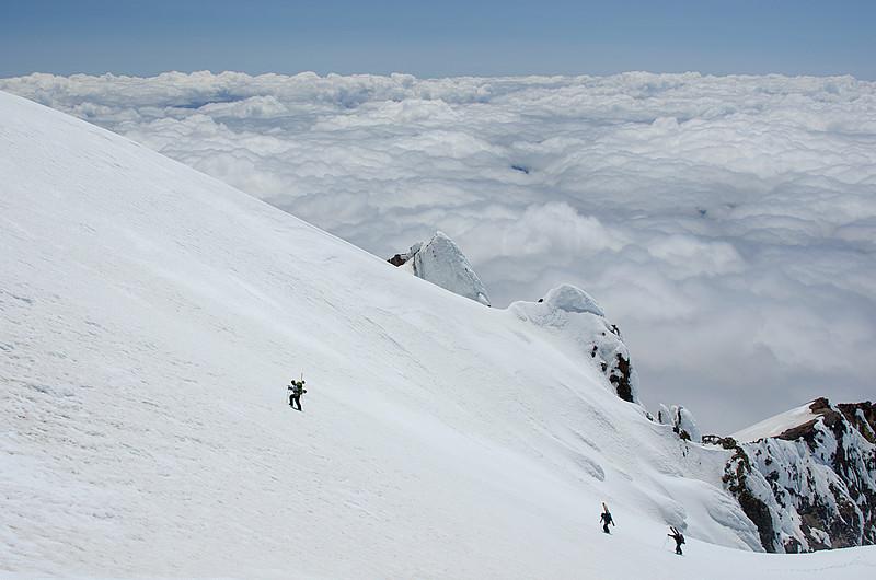 Skiers ascending Mt Hood near summit.