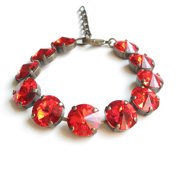 . Realia by Jen Swarovski ruby crystal bracelet in silver or brass setting ($110) at local boutiques and realiabyjen.com.