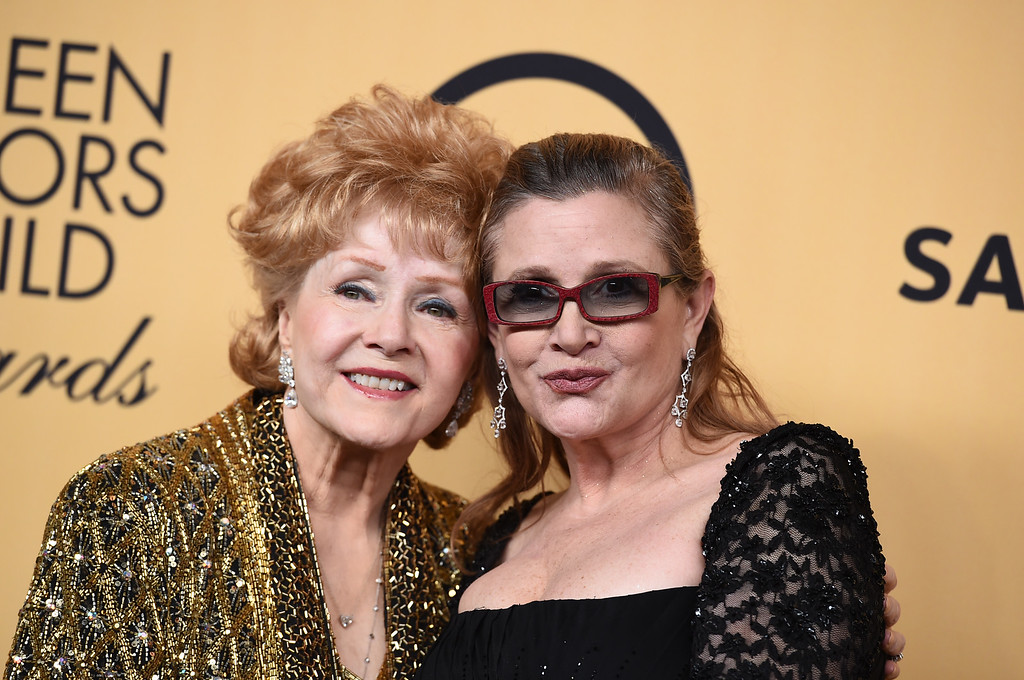 . Debbie Reynolds, winner of the Screen Actors Guild lifetime award, left, and Carrie Fisher pose in the press room at the 21st annual Screen Actors Guild Awards at the Shrine Auditorium on Sunday, Jan. 25, 2015, in Los Angeles. (Photo by Jordan Strauss/Invision/AP)