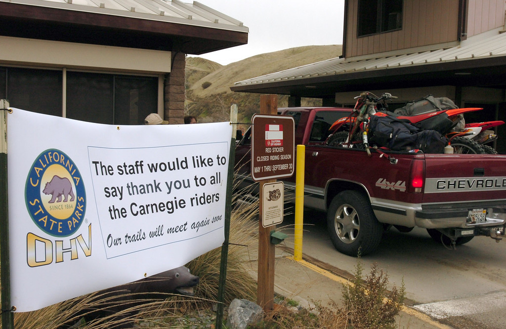 . A farewell sign greets participants as they enter Carnegie State Vehicular Recreation Area on Dec. 28, 2009, in Tracy, Calif., for a rally to save the off-road facility on Corral Hollow Road. In September, the Sportfishing Alliance and Public Employees for Environmental Responsibility sued the state, saying Carnegie lacked a permit from a state water board to allow pollution to flow into Corral Hollow Creek. If a stay to the ruling to close the park is not granted, dirt bikes and other all-terrain vehicles will be banned from Carnegie on Tuesday. (Cindi  Christie/Staff Archives)
