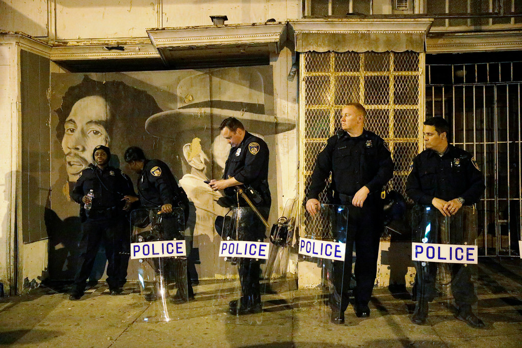. Police prepare ahead of a 10 p.m. curfew Wednesday, April 29, 2015, in Baltimore. The curfew was imposed after unrest in Baltimore over the death of Freddie Gray while in police custody. (AP Photo/Matt Rourke)