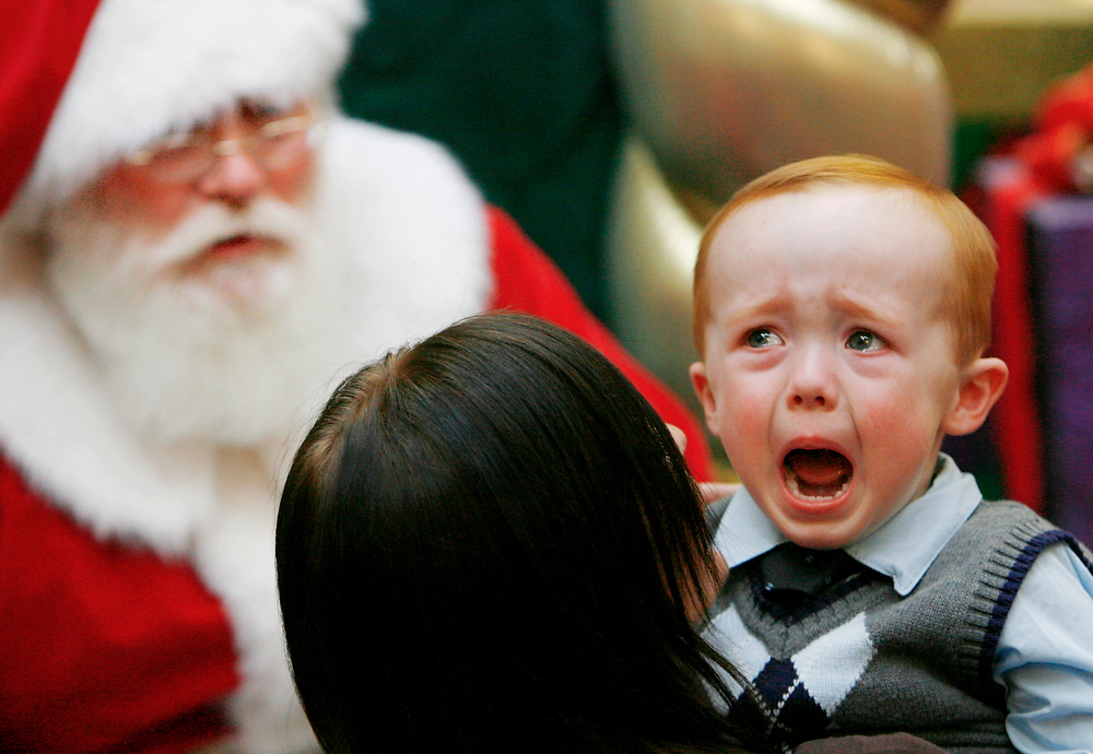 . Danny Nichols, breaks into tears at the thought of sitting on Santa\'s lap during a visit to Penn Square Mall in Oklahoma City, Dec. 12, 2008. (AP Photo/The Oklahoman, Jim Beckel)