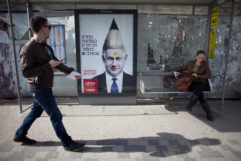 . A commercial poster for an Israeli school with the manipulated image Israeli Prime Minister Benjamin Netanyahu hangs on a bus stop ahead of the upcoming Israeli elections on January 18, 2013 in Tel Aviv, Israel. Israeli elections are scheduled for January 22 and so far showing a majority for the Israeli right. (Photo by Uriel Sinai/Getty Images) (Photo by Uriel Sinai/Getty Images)