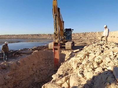 NPK GH18 hydraulic hammer on excavator trenching.jpg