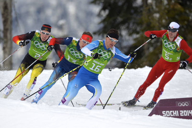 . From leftto right: Germany\'s Tim Tscharnke, Russia\'s Nikita Kriukov, Finland\'s Sami Jauhojaervi and Switzerland\'s Gianluca Cologna compete in the Men\'s Cross-Country Skiing Team Sprint Classic Final at the Laura Cross-Country Ski and Biathlon Center during the Sochi Winter Olympics on February 19, 2014 in Rosa Khutor near Sochi.   (ODD ANDERSEN/AFP/Getty Images)