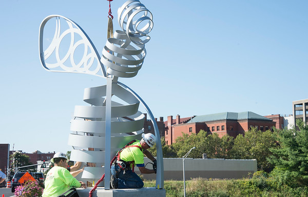 09/03/19 Wesley Bunnell | StaffrrThe final bee statue was hoisted into place onto the Bee Hive Bridge by Sign Pro on Tuesday September 3, 2019. Sign Pro President Peter Rappoccio , L, and Install Manager Rob Mulcunry help hold the bee steady as Spencer Brown bolts the statue into place.