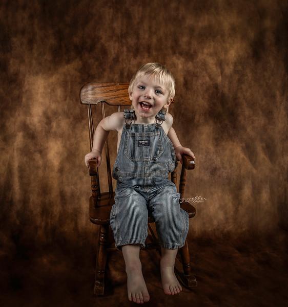 nick in chair, big smile drool.jpg