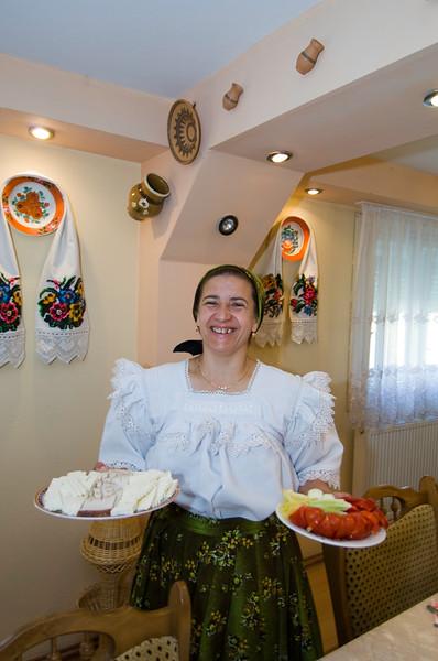 Homestay, landlady is serving breakfast, Maramures, Romania