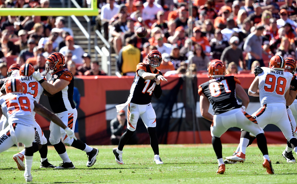 . Cincinnati Bengals quarterback Andy Dalton (14) passes against the Cleveland Browns in the first half of an NFL football game, Sunday, Oct. 1, 2017, in Cleveland. (AP Photo/David Richard)