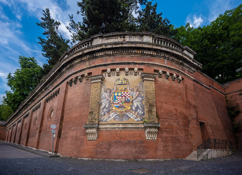 castle wall Buda Castle with coat of arms mosaic.jpg