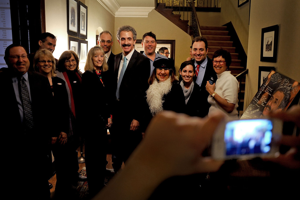 . City Attorney candidate Mike Feuer poses for a photo with supporters during his election night party in Los Angeles, CA March 5, 2013.(Andy Holzman/Los Angeles Daily News)