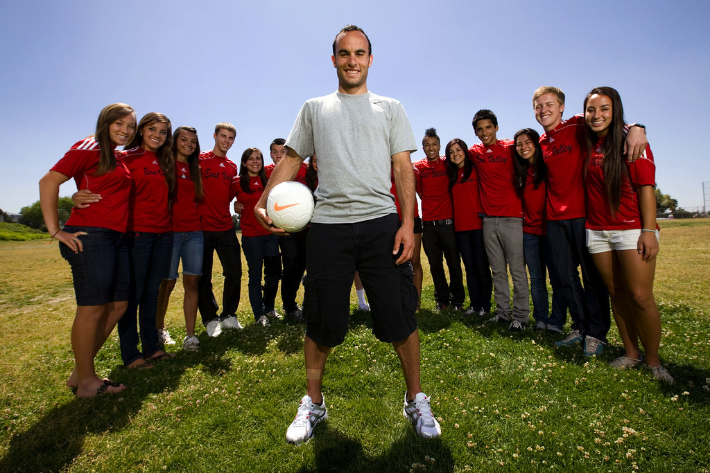 . Landon Donovan poses for a photo with soccer players from Redlands East Valley High School, where he himself played, Monday, April 19, 2010. (Staff file photo/Redlands Daily Facts)