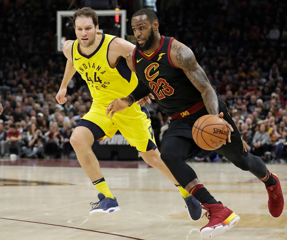 . Cleveland Cavaliers\' LeBron James (23) drives past Indiana Pacers\' Bojan Bogdanovic (44), from Croatia, in the first half of Game 7 of an NBA basketball first-round playoff series, Sunday, April 29, 2018, in Cleveland. (AP Photo/Tony Dejak)
