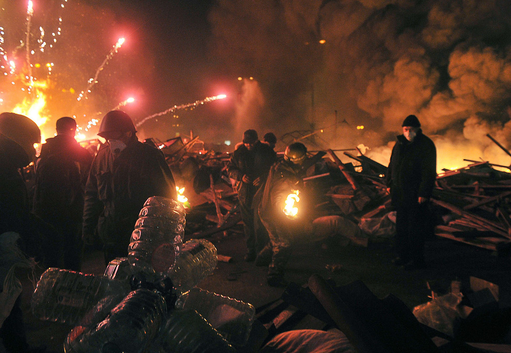 . Anti-government protesters clash with the police during their storming of Independence Square in Kiev on February 18, 2014. AFP PHOTO/ GENYA  SAVILOV/AFP/Getty Images