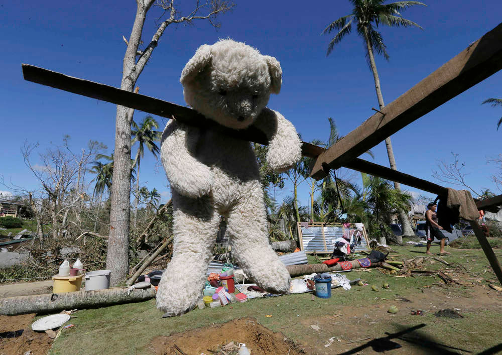 Description of . A stuffed toy hangs to dry from a damaged house at New Bataan township, Compostela Valley in southern Philippines Saturday Dec. 7, 2012. Search and rescue operations following typhoon Bopha that killed nearly 600 people in the southern Philippines have been hampered in part because many residents of this ravaged farming community are too stunned to assist recovery efforts, an official said Saturday. (AP Photo/Bullit Marquez)