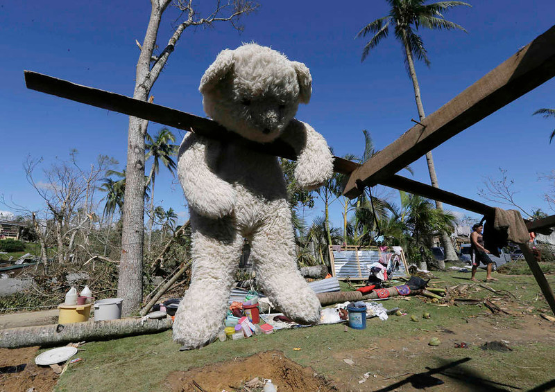 . A stuffed toy hangs to dry from a damaged house at New Bataan township, Compostela Valley in southern Philippines Saturday Dec. 7, 2012. Search and rescue operations following typhoon Bopha that killed nearly 600 people in the southern Philippines have been hampered in part because many residents of this ravaged farming community are too stunned to assist recovery efforts, an official said Saturday. (AP Photo/Bullit Marquez)