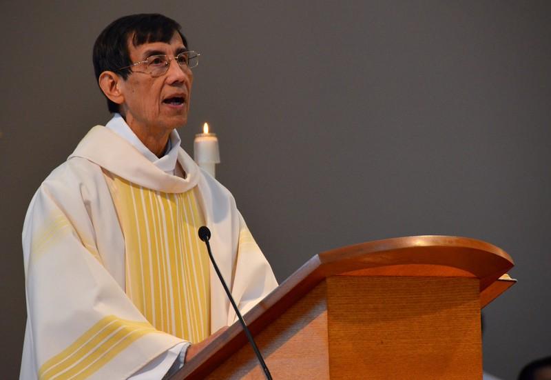 The deacon reads the Gospel