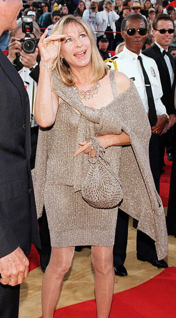 . Barbra Streisand waves to photographers as she arrives at the 69th Annual Academy awards 24 March in Los Angeles, California.  (Vince Bucci/AFP/Getty Images)