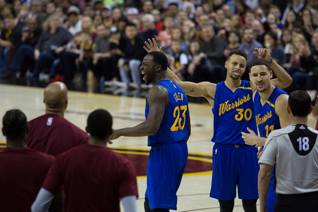 . The Golden State Warriors\' Draymond Green (23), Stephen Curry (30), and Klay Thompson (11) argue with a referee about a foul call during an NBA game at the Quicken Loans Arena on Christmas day.  The Cavs defeated the Warriors 109-108.  Michael Johnson - The News Herald