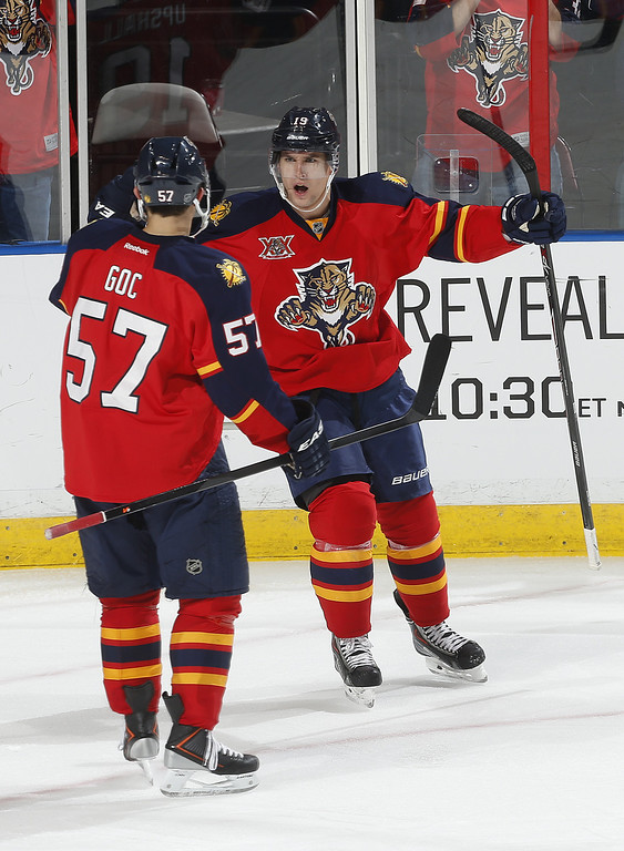 . SUNRISE, FL - JANUARY 24: Scottie Upshall #19 i congratulated by Marcel Goc #57 of the Florida Panthers after scoring a third period goal against the Colorado Avalanche at the BB&T Center on January 24, 2014 in Sunrise, Florida. The goal by Upshall was his 100th NHL goal. The Avalanche defeated the Panthers 3-2. (Photo by Joel Auerbach/Getty Images)
