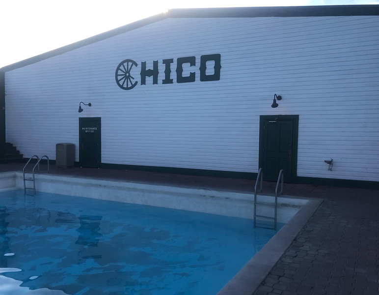 Corner of pool next to building with chico written on it