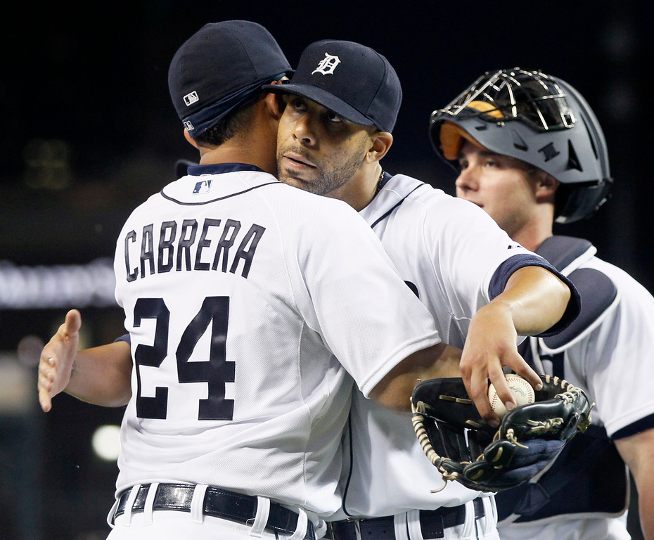 . Detroit Tigers pitcher David Price gets a hug from Miguel Cabrera (24) after pitching a complete baseball game in a 4-0 win over the Cleveland Indians Friday, June 12, 2015, in Detroit. It was Price\'s second complete game in as many starts. (AP Photo/Duane Burleson)