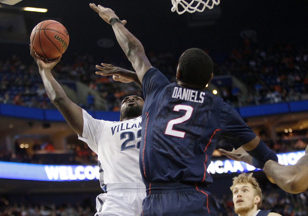 . Villanova\'s JayVaughn Pinkston (22) shoots over Connecticut\'s DeAndre Daniels (2) during the first half of a third-round game in the NCAA men\'s college basketball tournament in Buffalo, N.Y., Saturday, March 22, 2014. (AP Photo/Bill Wippert)