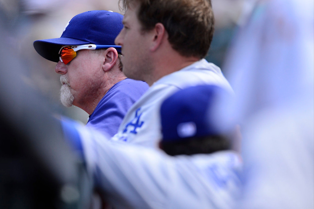 . Los Angeles Dodgers hitting coach Mark McGwire takes in the action against the Colorado Rockies during the action in Denver on Monday, September 2, 2013. The Colorado Rockies hosted the Los Angeles Dodgers at Coors Field.   (Photo by AAron Ontiveroz/The Denver Post)