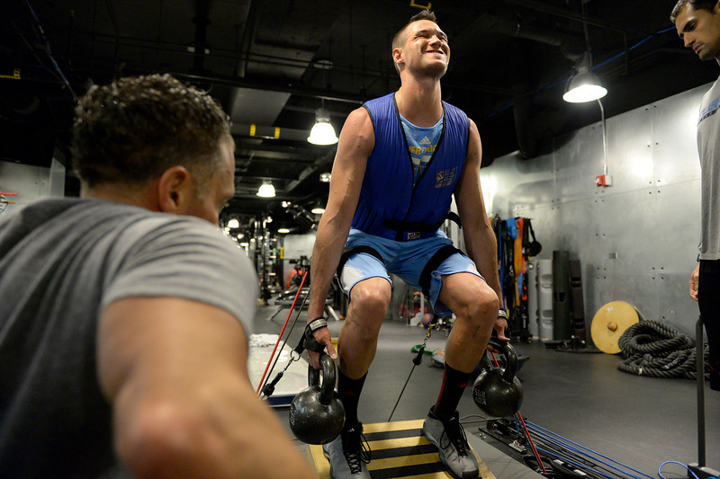 . Denver Nuggets Danilo Gallinari is carefully watched by assistant coach/strength and conditioning Steve Hess (L) May 27, 2014 at Pepsi Center. Gallinari rehabbing his knee he injured against the Mavericks on April 4, 2013.  (Photo by John Leyba/The Denver Post)
