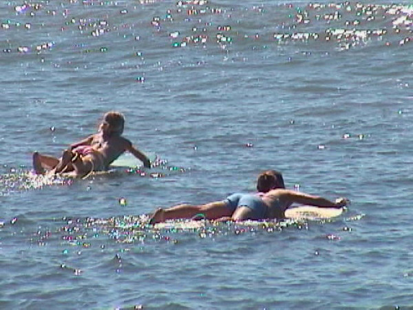 Bristol and Tiffany paddling out.jpg
