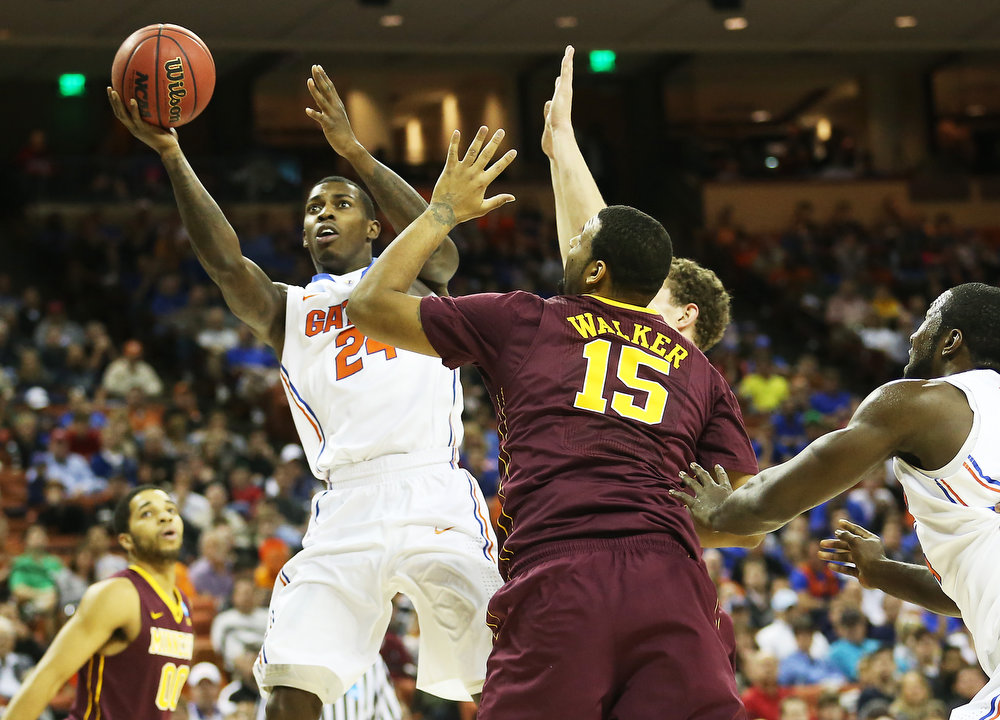 . Casey Prather #24 of the Florida Gators goes up against Maurice Walker #15 of the Minnesota Golden Gophers in the first half during the third round of the 2013 NCAA Men\'s Basketball Tournament at The Frank Erwin Center on March 24, 2013 in Austin, Texas.  (Photo by Ronald Martinez/Getty Images)