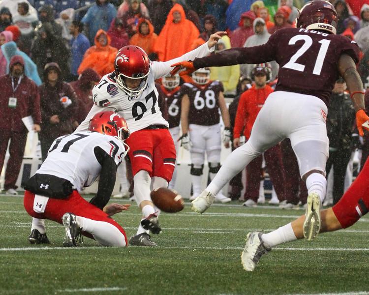 Cincinnati kicker #97 Ryan Jones kicks an extra point