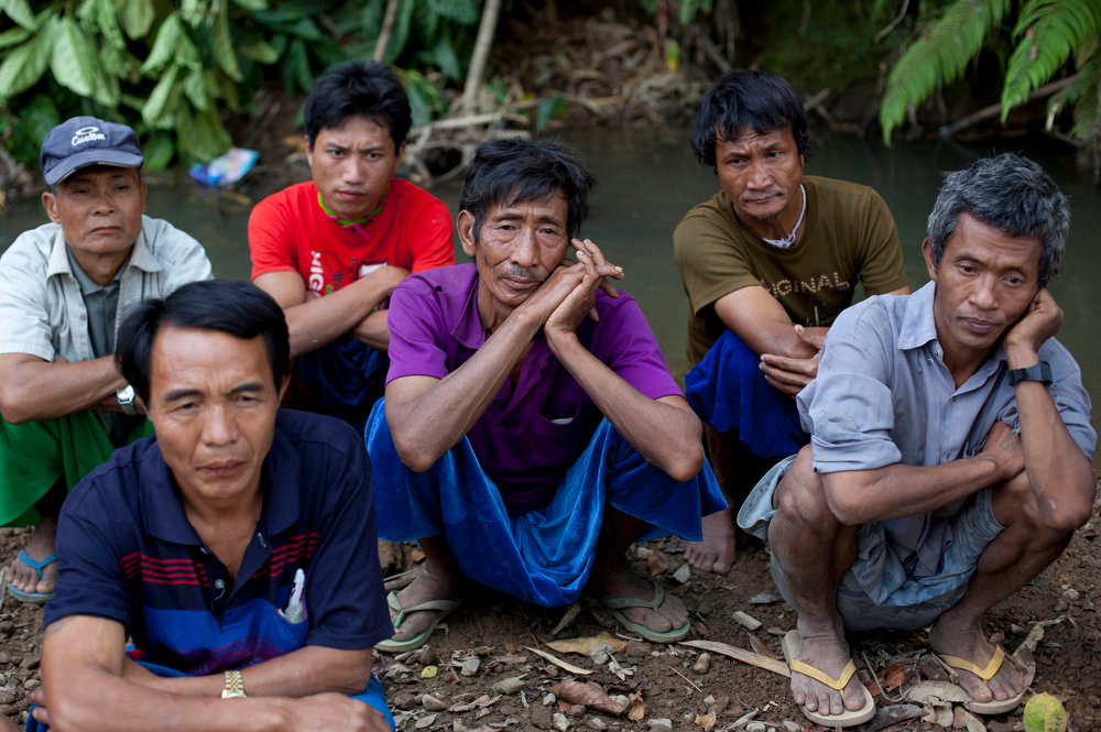 . Ethnic Lisu men gather for a meeting close to Mong Pan village, central Shan state, Myanmar on Feb 21, 2013. Far from Myanmar\'s postcard-perfect pagodas and colonial relics, the remote mountain villages of southern Shan State do not appear on maps of Myanmar or in any guide books. In obscurity, they have been ground zero for Myanmar\'s drug trade which has thrived on poverty and corruption. (AP Photo/Gemunu Amarasinghe)