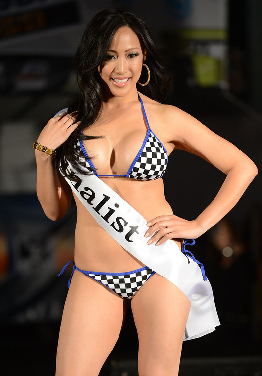 . Long Beach, Calif., -- 04-18-13-  Finalist Roxanne Santiago competes in the 2013 Tecate Light Miss Toyota Grand Prix of Long Beach  pageant Thursday night on Pine Avenue at the Tecate Light Thunder Thursday on Pine.   Stephen Carr/  Los Angeles Newspaper Group