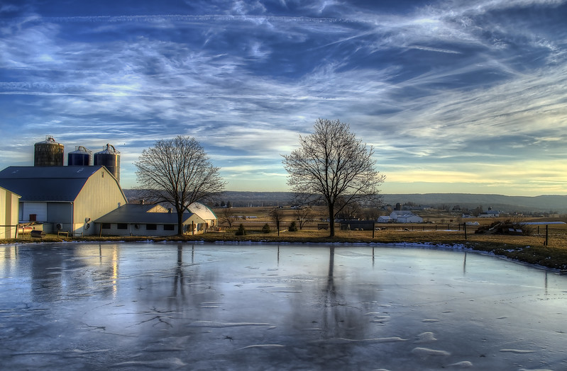 reflections - frozen pond and farm(p, 201).jpg