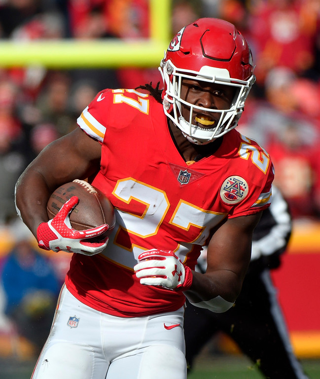. Kansas City Chiefs running back Kareem Hunt (27) carries the ball during the first half of an NFL football game against the Miami Dolphins in Kansas City, Mo., Sunday, Dec. 24, 2017. (AP Photo/Ed Zurga)