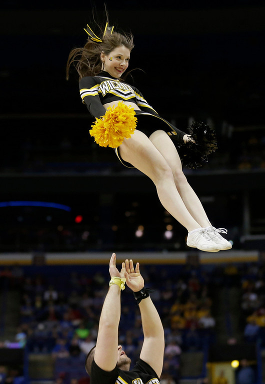 . Wichita State cheerleaders perform during the first half of a second-round game against Cal Poly in the NCAA college basketball tournament Friday, March 21, 2014, in St. Louis. (AP Photo/Charlie Riedel)