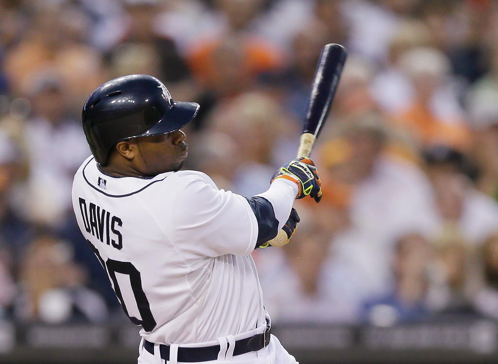 . Detroit Tigers\' Rajai Davis swings on a two-run home run off Kansas City Royals starting pitcher Jason Vargas during the second inning of a baseball game in Detroit, Tuesday, Sept. 9, 2014. (AP Photo/Carlos Osorio)