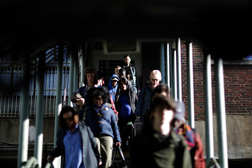 . Travelers walk down a stairwell to board an Amtrak train heading to New Orleans in Atlanta, Wednesday, Nov. 23, 2016. Almost 49 million people are expected to travel 50 miles or more for the holiday, the most since 2007, according to AAA. (AP Photo/David Goldman)
