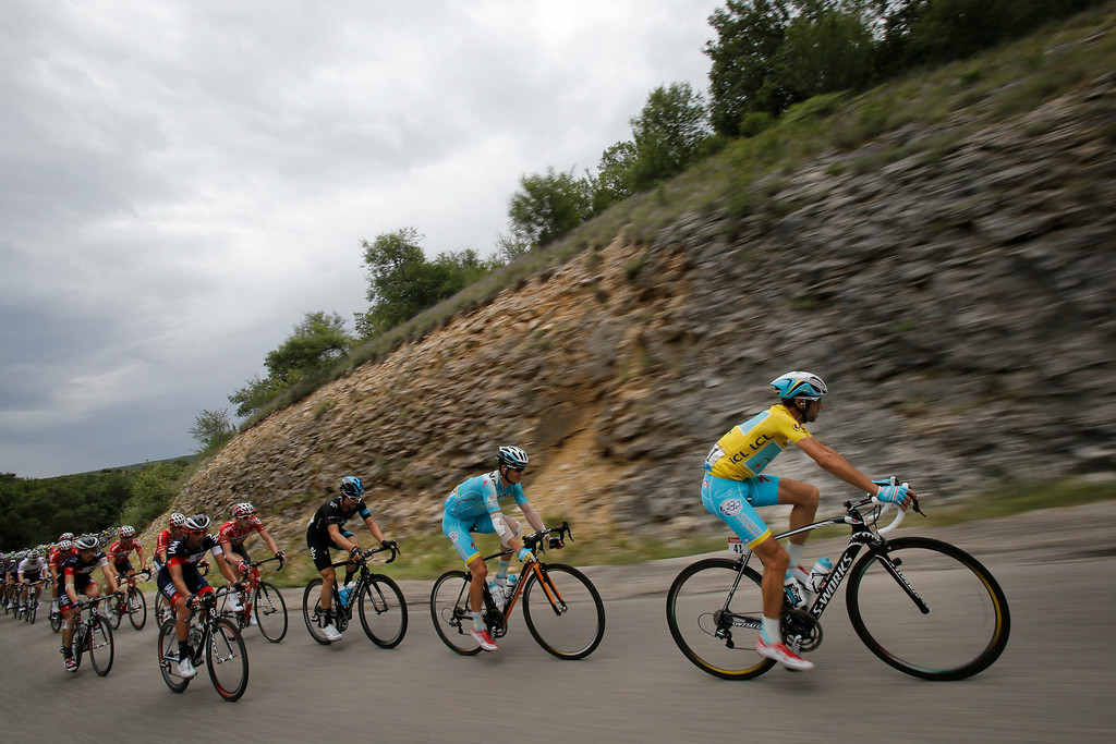 . Denmark\'s Jakob Fuglsang, second right,  follows teammate and overall leader Italy\'s Vincenzo Nibali, right, during the fifteenth stage of the Tour de France cycling race over 222 kilometers (137.9 miles) with start in Tallard and finish in Nimes, France, Sunday, July 20, 2014. (AP Photo/Christophe Ena)