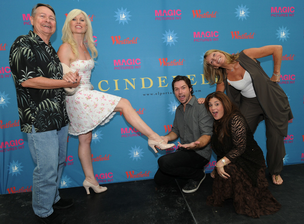 """. Judges (L-R) John Holly, actress Charley King, Michael Johns from \""""American Idol\"""", Carolyn Darnell and producer/director Bonnie Lythgoe pose for a photo as they take a break during the talent search for the next \""""Cinderella\"""" at Culver City in Los Angeles on July 14, 2010.                (MARK RALSTON/AFP/Getty Images)"""
