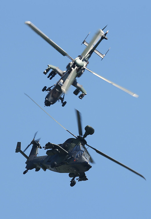 . Eurocopter Tiger EC665 military attack helicopters of the French and German air forces fly together at the ILA 2014 Berlin Air Show on May 21, 2014 in Schoenefeld, Germany. The ILA 2014 is open from may 20-25.  (Photo by Sean Gallup/Getty Images)