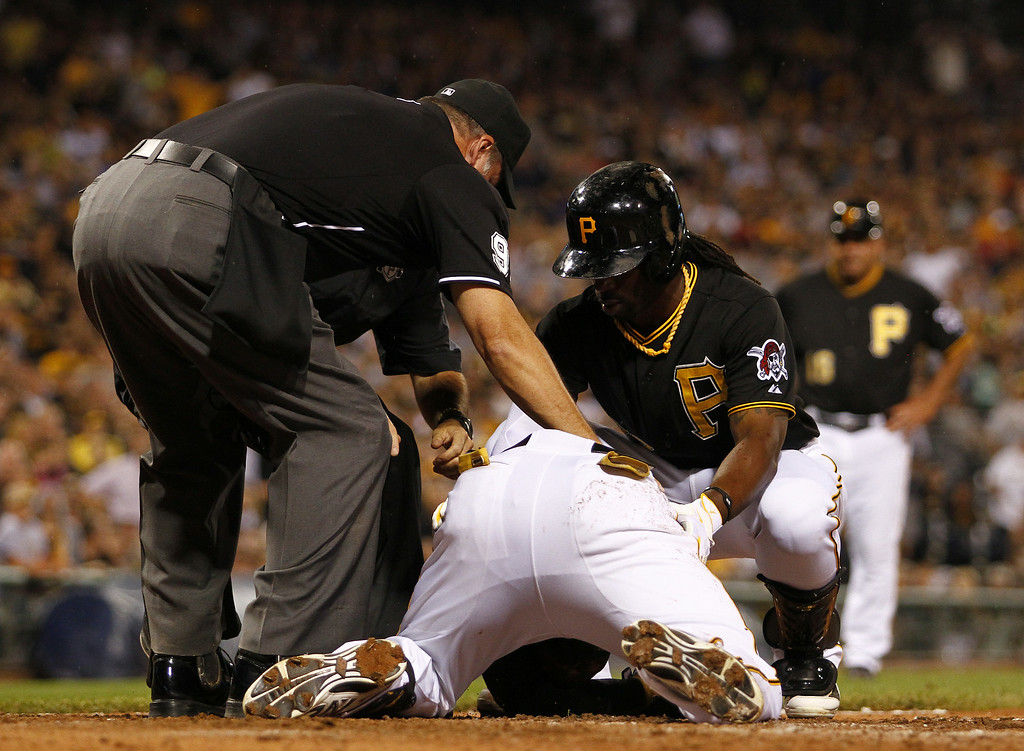 . PITTSBURGH, PA - JULY 18: Home plate umpire Tim Timmons and Andrew McCutchen #22 check on Starling Marte #6 of the Pittsburgh Pirates after being hit in the head with a pitch in the seventh inning against the Colorado Rockies during the game at PNC Park July 18, 2014 in Pittsburgh, Pennsylvania. (Photo by Justin K. Aller/Getty Images)