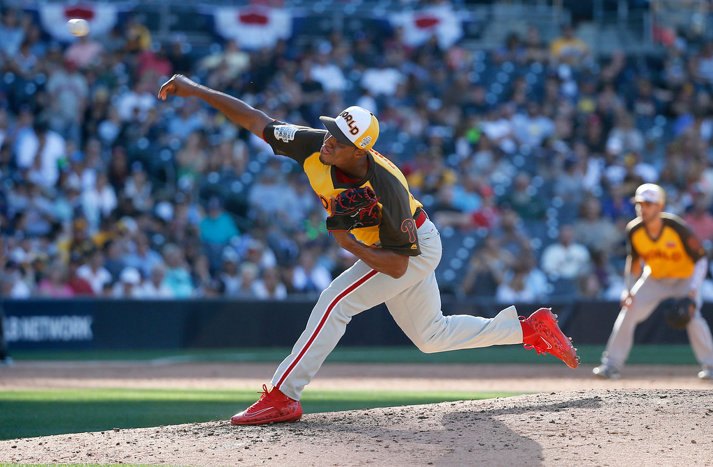 . World Team\'s Ricardo Pinto, of the Philadelphia Phillies, throws against the U.S. Team during the sixth inning of the All-Star Futures baseball game, Sunday, July 10, 2016, in San Diego. (AP Photo/Lenny Ignelzi)