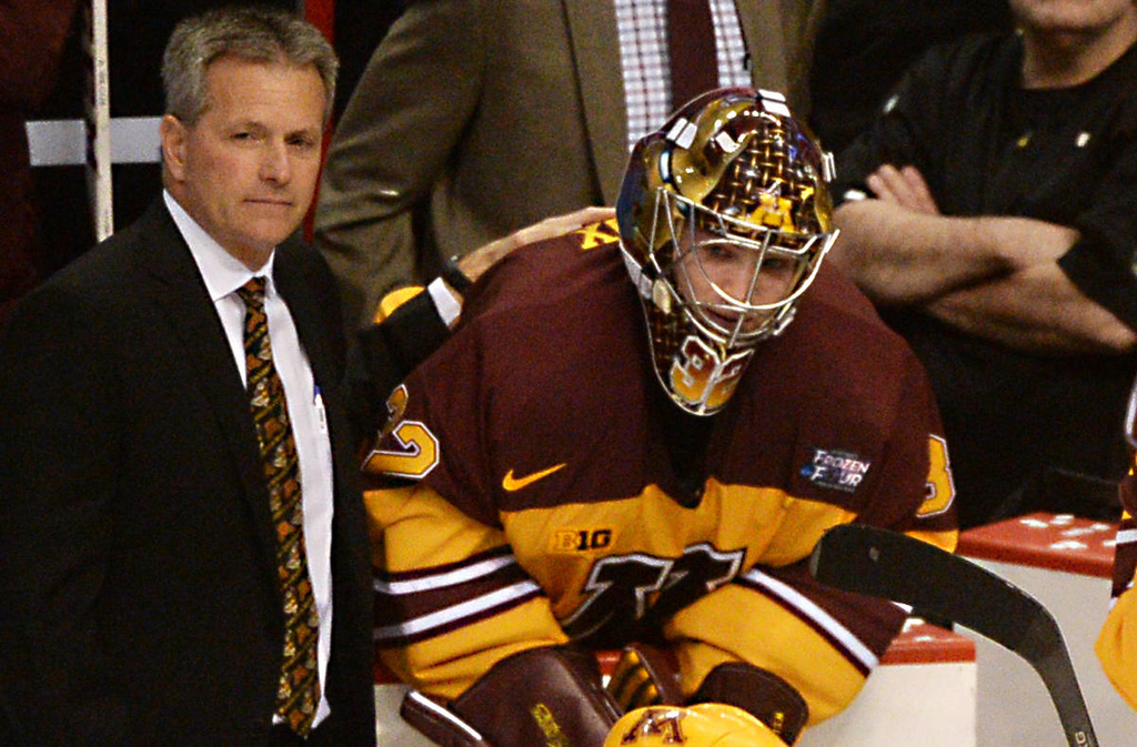 . Minnesota head coach Don Lucia and sophomore goalie Adam Wilcox look on as Union College celebrate their 7-4 victory over the Gophers in the NCAA Frozen Four Championship Game at the Wells Fargo Center in Philadelphia, Saturday, April 12, 2014.  (Pioneer Press: John Autey)