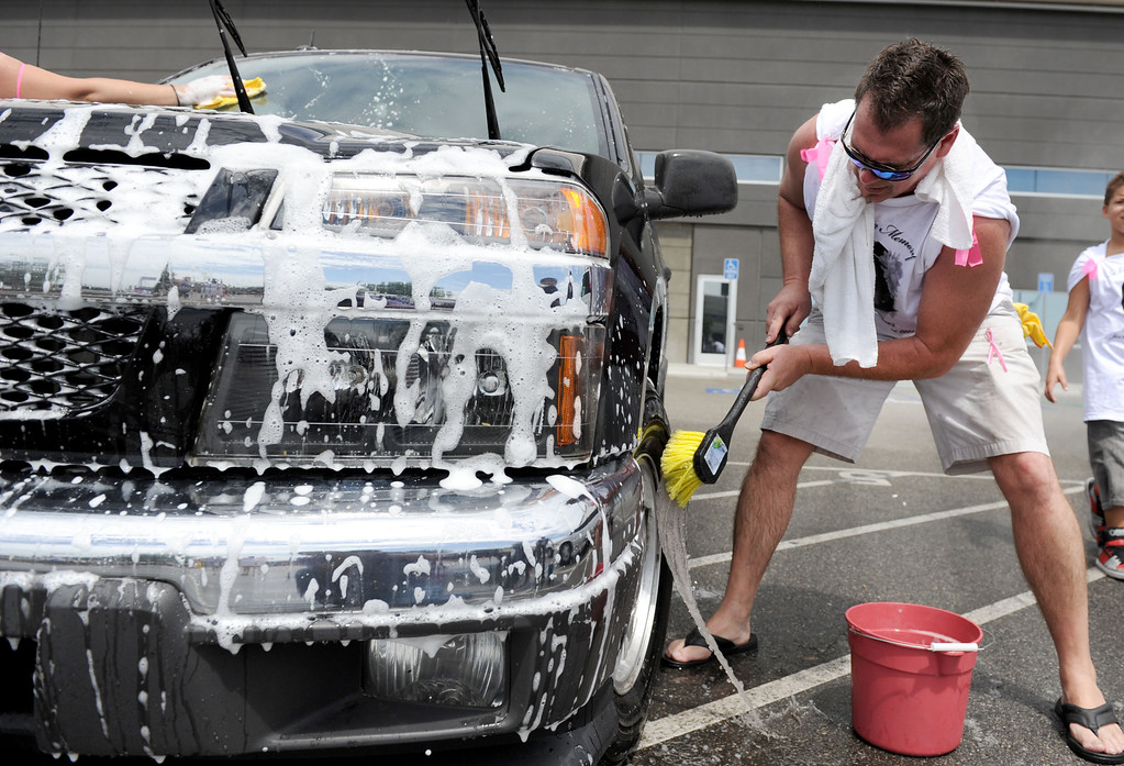 . (John Valenzuela/Staff Photographer) Russell Loy helps wash a car during the bike/car wash fundraiser in memory of his granddaughter Breann Creer at the Citizens Business Bank Arena in Ontario, Saturday, August 31, 2013. Creer, 4, who died earlier this week when the motorcycle she was riding on collided with a big rig in Rancho Cucamonga.