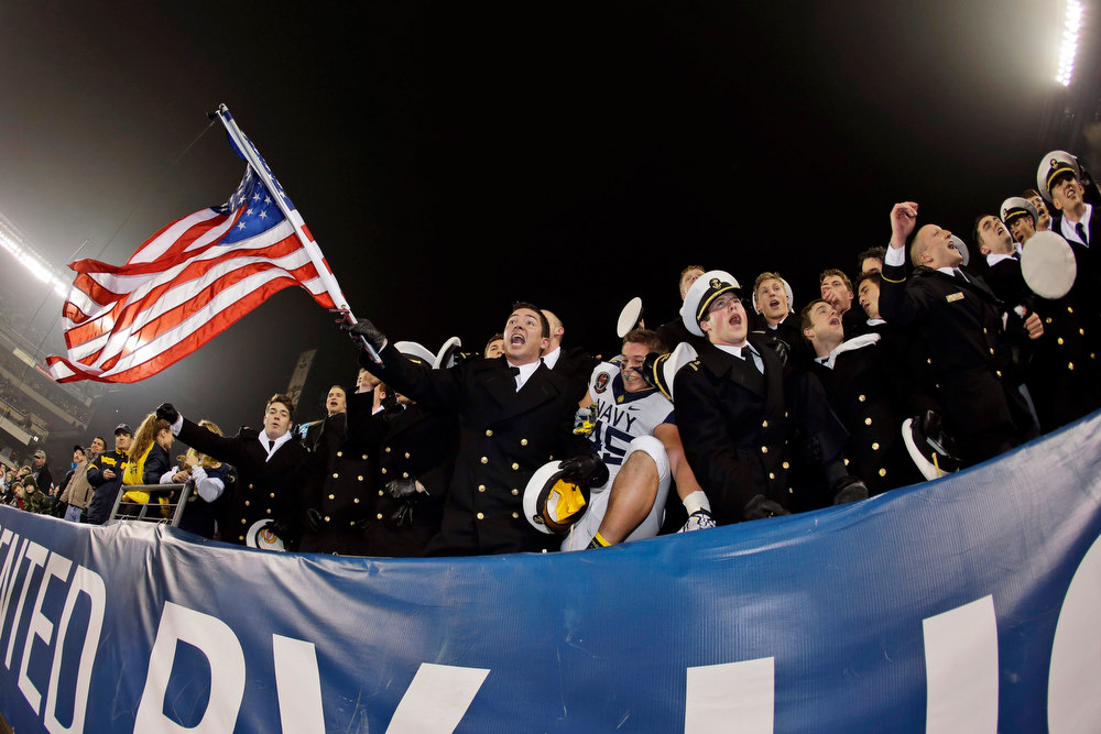 . Navy Midshipmen celebrate after their 17-13 win over Army in an NCAA college football game, Saturday, Dec. 8, 2012, in Philadelphia. Navy won 17-13. (AP Photo/Matt Slocum)