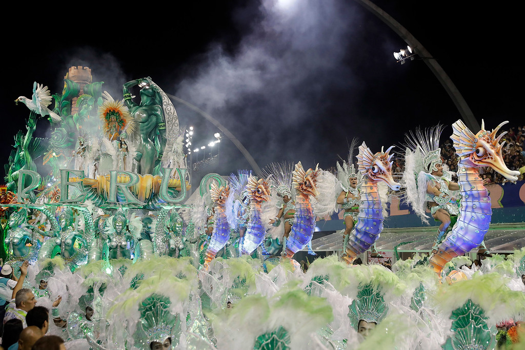 . Dancers from the Unidos do Peruche samba school perform on a float during a carnival parade in Sao Paulo, Brazil, early Sunday, Feb. 26, 2017. (AP Photo/Andre Penner)