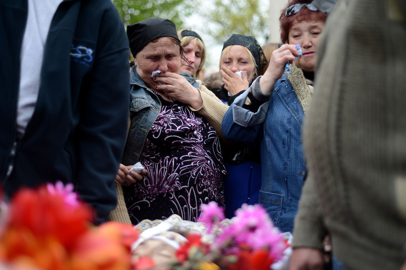 . Relatives of men killed in a gunfight on April 20, 2014, attend the funeral ceremony in the eastern Ukrainian city of Slavyansk on April 22, 2014. US Vice President Joe Biden met Ukraine\'s new pro-Western leaders Tuesday to offer firm American backing as Washington and Moscow traded blame over an unravelling peace deal to defuse the country\'s deep crisis. Under the deal signed by Ukraine, Russia, the United States and the European Union last week, pro-Kremlin rebels holding a string of eastern towns were supposed to disarm and give up the state buildings they have seized.  (KIRILL KUDRYAVTSEV/AFP/Getty Images)