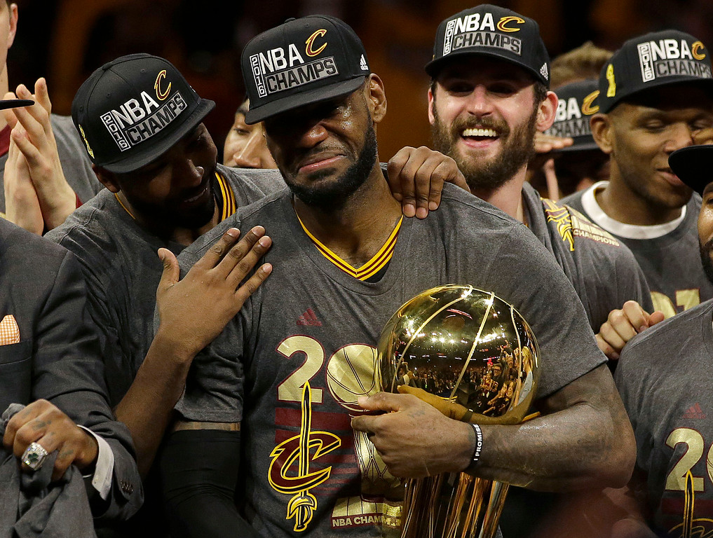 . Cleveland Cavaliers forward LeBron James, center, celebrates with teammates after Game 7 of basketball\'s NBA Finals against the Golden State Warriors in Oakland, Calif., Sunday, June 19, 2016. The Cavaliers won 93-89, ending the city\'s 52-year championship drought. (AP Photo/Marcio Jose Sanchez)